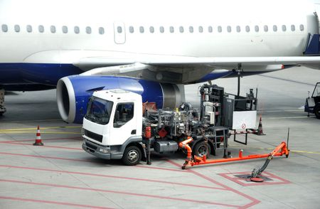 refueling: airplane is being refueled in the airport