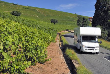 Caravan on its way in France between the vineyards in Beaujolais Stock Photo