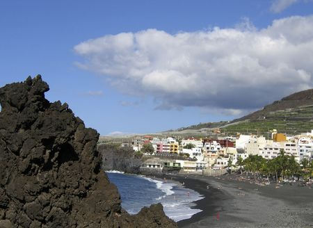 View at the beach of Puerto Naos, La Palma. This Spanish island has a volcanic black beach.