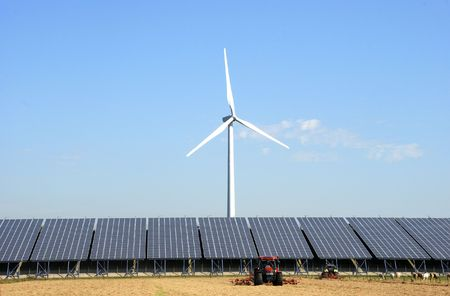 Solar plant with wind turbine at a farm in the Netherlands.In front two tractors Stock Photo
