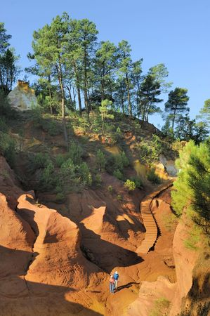 roussillon: This picture was taken just as the sun was setting in Rousillon, France during late summer. It captures the red ochre, which is mined in Roussillon. Stock Photo