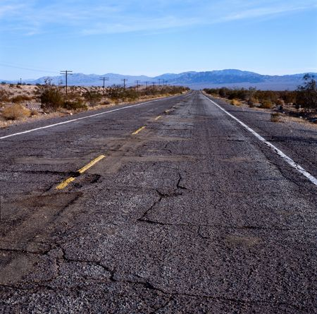 The old Route 66 with damaged pavement in the Mohave desert, California,U.S.A. photo