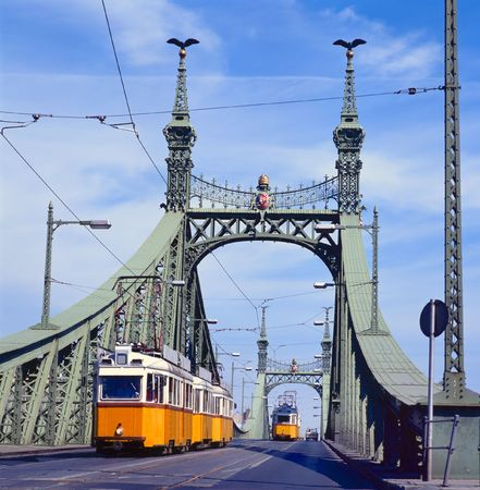 yeloow: The green Freedom Bridge, with yeloow tram, in Budapest,the capital of Hungary