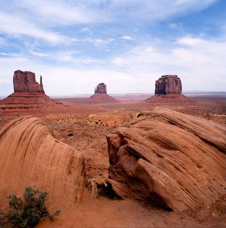 Rock formations with sage brush in the Navajo park Monument Valley