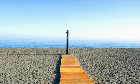 planking: planking and shower at the beach in the morning without people