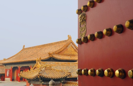 red wooden door entrance to Forbidden City,Beijing,China photo