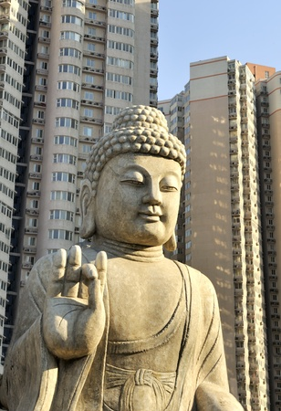 budha: Budha situated between apartment buildings in Beijing, China