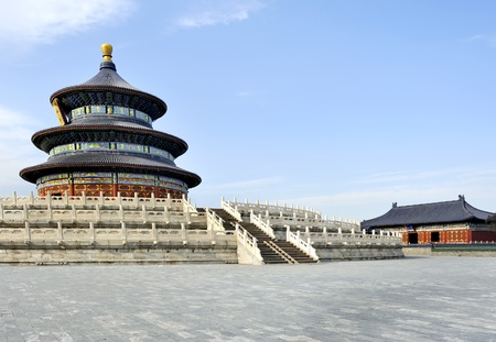 temple of heaven: The Imperial Vault of Heaven sits in the centre. It is a round building with a roof that resembles the Hall of Prayer for Good Harvests, though smaller and with only one gable of eaves and a single tier marble base. The back half of the building is constr Stock Photo
