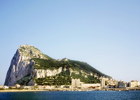 Gibraltar on a sunny day seen from across the bay. Stockfoto