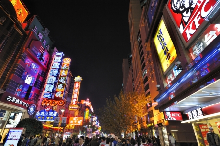 retail scenes: Shanghai, China – November 19, 2011: Neon signs on Nanjing Road at Night. Nanjing Road is the #1 shopping street in China with over 600 stores and million visitors per day. It is also famous for its neon lights at night, a must-see landmark in Shanghai.  Editorial