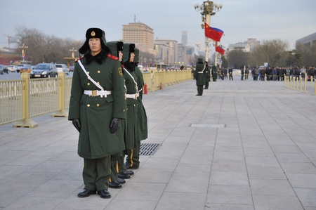 BEIJING, CHINA- December 13, 2010; Military guards stand guard in front of the Forbidden City of Beijing.