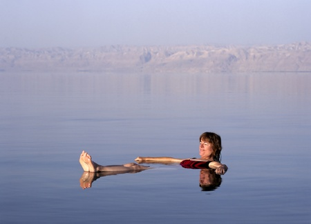 Girl floating at the Dead Sea, Jordan