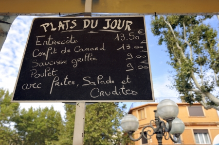 plats: Menusign in France with the plats du jour; that nmenas the meals of the day Stock Photo