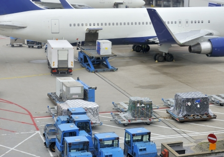Loading an aeroplane with airfreight at an airport  Stock Photo