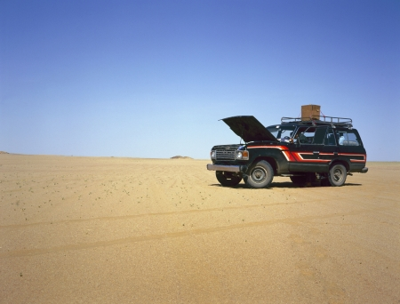 Broken down four wheel drive in the middle of the desert Stock Photo