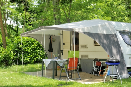 camping: Caravan with a awning at a camp site