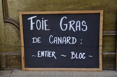 adboard: Adboard for foie gras de canard in front of shop in France
