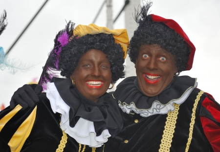 santa s helper: Leidschendam, Holland - November 13, 2010  Two Black Petes laughing in the camera during the arrival of Sinterklaas in Holland  November 13, 2010 Leidschendam, Holland