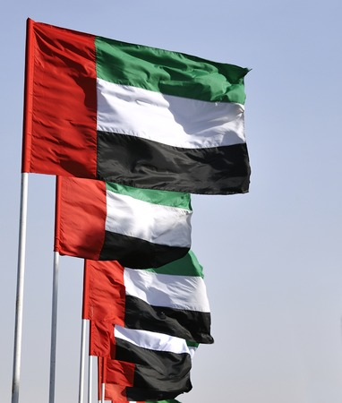 dubai flag: Flags of the United Arab Emirates  It contains the Pan-Arab colors red, green, white and black, which symbolize Arabian unity  Stock Photo