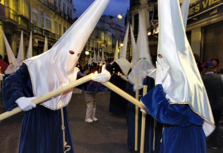 semana santa: Processions of Nazarenos walk the streets during the Semana Santa  Holy week before Easter  in Malaga, Spain