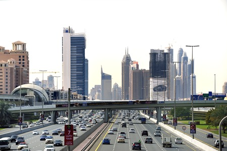 Dubai, United Arab Emirates-February 8, 2014 Traffic at the Sheikh Zayed Road with at the background the city center with the Burj Khalifa  This road is the busiest place in the UAE, connecting all five Emirates  February 8, 2014 Dubai, United Arab Emirat