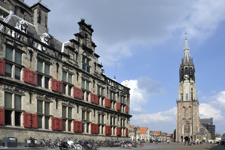 De New Church and the Townhall at the Market place of Delft  In this church the Dutch Royal Family is burried