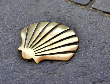 Saint James way shell golden metal on streets photo