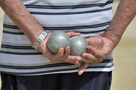 boules: Man playing jeu de boules or also called petanque  Stock Photo