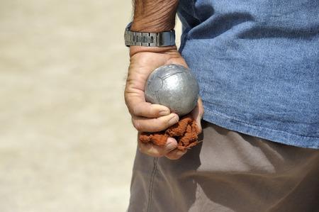 Man playing jeu de boules or also called petanque  Stock Photo