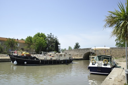 gascony: Boats at the Canal de Midi at the village of Capestang in Southern France