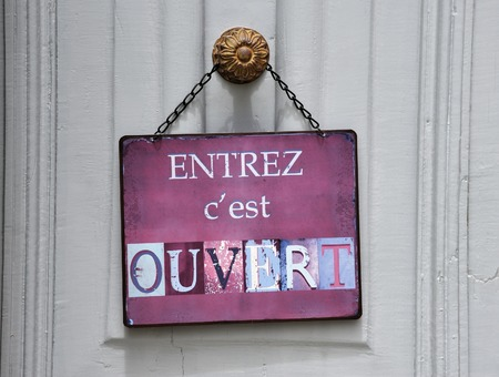 shop opening hours: sign at a shop with the french text: entreze c Stock Photo