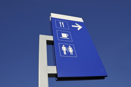 water closet: Signs to restaurant and toilets alongside a French highway