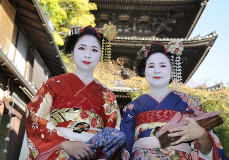 japanese ethnicity: Kyoto,Japan - November 4, 2014: Geisha women in traditional dress. Kyoto is center of Japan