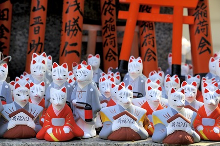 explains: Fushimi Inari Shrine - near Kyoto, Japan. Mini fox statues available for purchase. Inari is the god of rice and Inari is also the god of foxes. This explains why there are so many fox statues in this shrine.