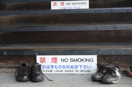 shoes off: At the entrance of a temple in Japan you are requested to leave your shoes outside and do not smoke