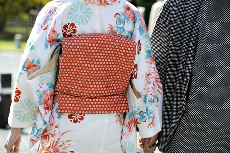 Geisha woman together with her husband both in traditional dress. Kyoto is center of Japan Stockfoto