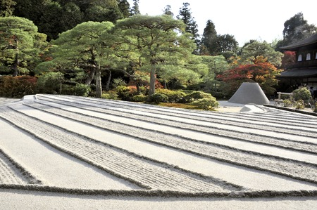 treetops: Kyoto,Japan-November 10, 2014; Zen garden with sand tower named Kogetsudai, representing fuji montain.November 10, 2014, Kyoto, Japan