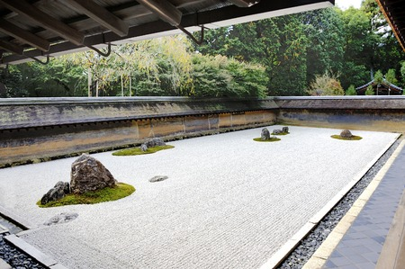 rock garden: Zen Rock Garden in Ryoanji Temple, Kyoto, Japan. In the garden there are fifteen stones on white gravel.