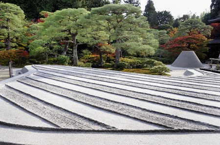 Kyoto, Japan-November 10, 2014; Zen garden with sand tower named Kogetsudai, representing fuji montain.November 10, 2014, Kyoto, Japan