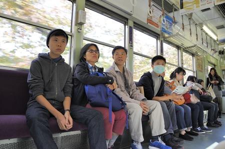 onboard: Kyoto, Japan- November 10, 2014; People ride in the subway.November 10, 2014 Kyoto, Japan Editorial