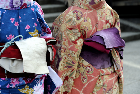 maiko: Kyoto, Japan - November 4: Geishas wearing kimonos, selective focus at the right geisha.This is a traditional Japanese dress. Kyoto is also known as the capital of the Geisha world. November 4, 2014 Kyoto, Japan