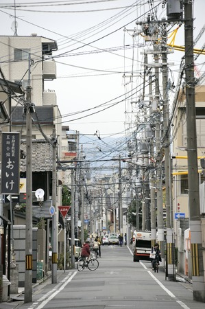 telephone poles: Kyoto,Japan-November 8, 2014; Street in old suburb with telephone poles and traffic.November 8, 2014 Kyoto, Japan Editorial