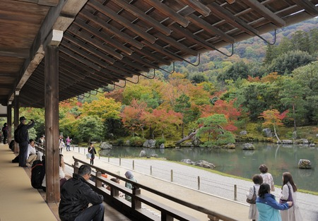 unesco world cultural heritage: Kyoto, Japan-November 5, 2014; View at the Tenryu-ji Sogenchi Garden where people watch the splendid colors of the trees. This is a Unesco World Cultural Heritage site.November 5, 2014 Kyoto, Japan