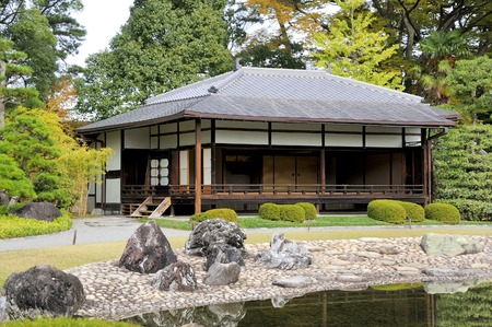 extends: Kyoto,Japan-November 8, 2014; Outside of the Ninomaru Palace at the Nijo Castle extends the Ninomaru Garden a traditional Japanese landscape garden with a large pond and ornamental stones.November 8, 2014, Kyoto, Japan Editorial