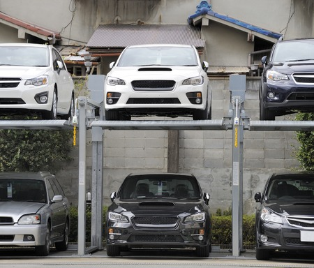 crowded space: Kyoto, Japan-November 5, 2014: Double story parking in the city center.November 5, 2014 Kyoto, Japan Editorial