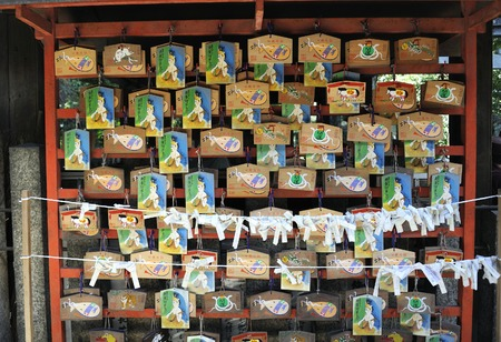 ema: Kyoto,Japan - November 3, 2014: Japanese votive plaques (Ema) hanging in Gyoganji temple. Ema are small wooden plaques used for wishes by shinto believers.November 3, 2014 Kyoto, Japan