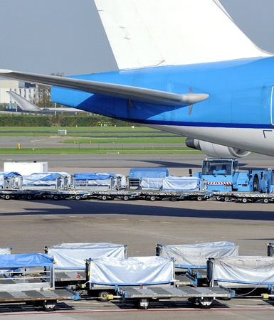 Loading an airplane with airfreight at an airport photo