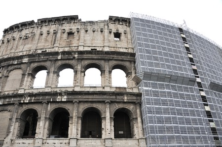 scaffolds: The Colosseum in Rome,Italy with Scaffolds Stock Photo
