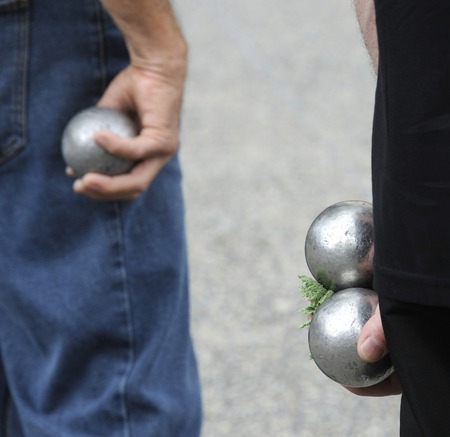 petanque: Playing jeu de boules or also called petanque in France. This play is played at street in every village of France. Selective focus at right balls.