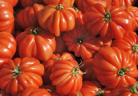 greengrocer: Ripe beefsteak tomatoes at a greengrocer in France Stock Photo
